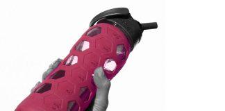 Pink Waterbottle in Women's Hand